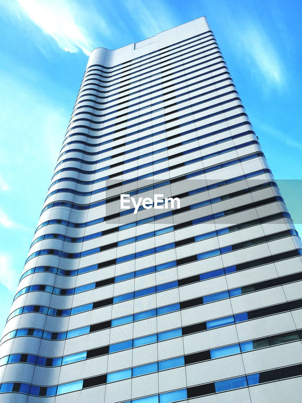 low angle view, architecture, sky, skyscraper, modern, building exterior, built structure, cloud - sky, day, outdoors, city, blue, no people