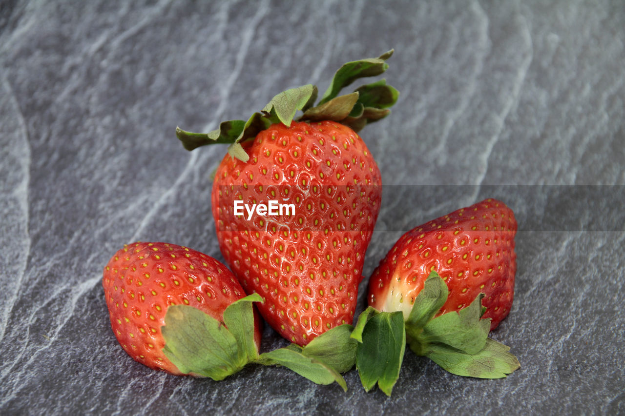 Close-up of strawberries on slate