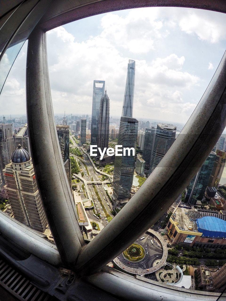 architecture, city, cityscape, built structure, building exterior, skyscraper, sky, cloud - sky, modern, day, no people, outdoors, travel destinations, urban skyline