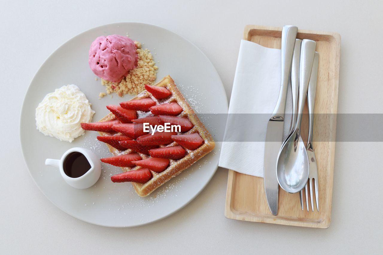 Dessert in plate over white background