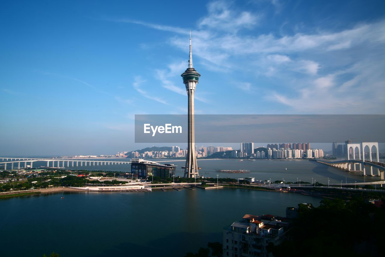 Macau Tower Amidst Sea Against Sky