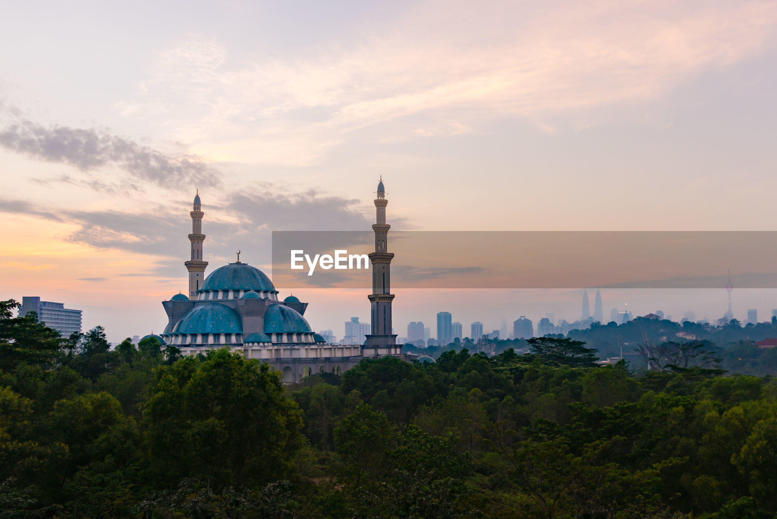Federal territory mosque against sky during sunset