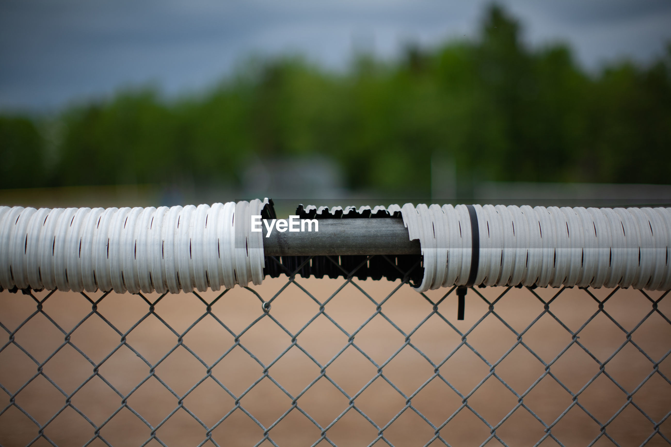 Close-up of metal pipes on land