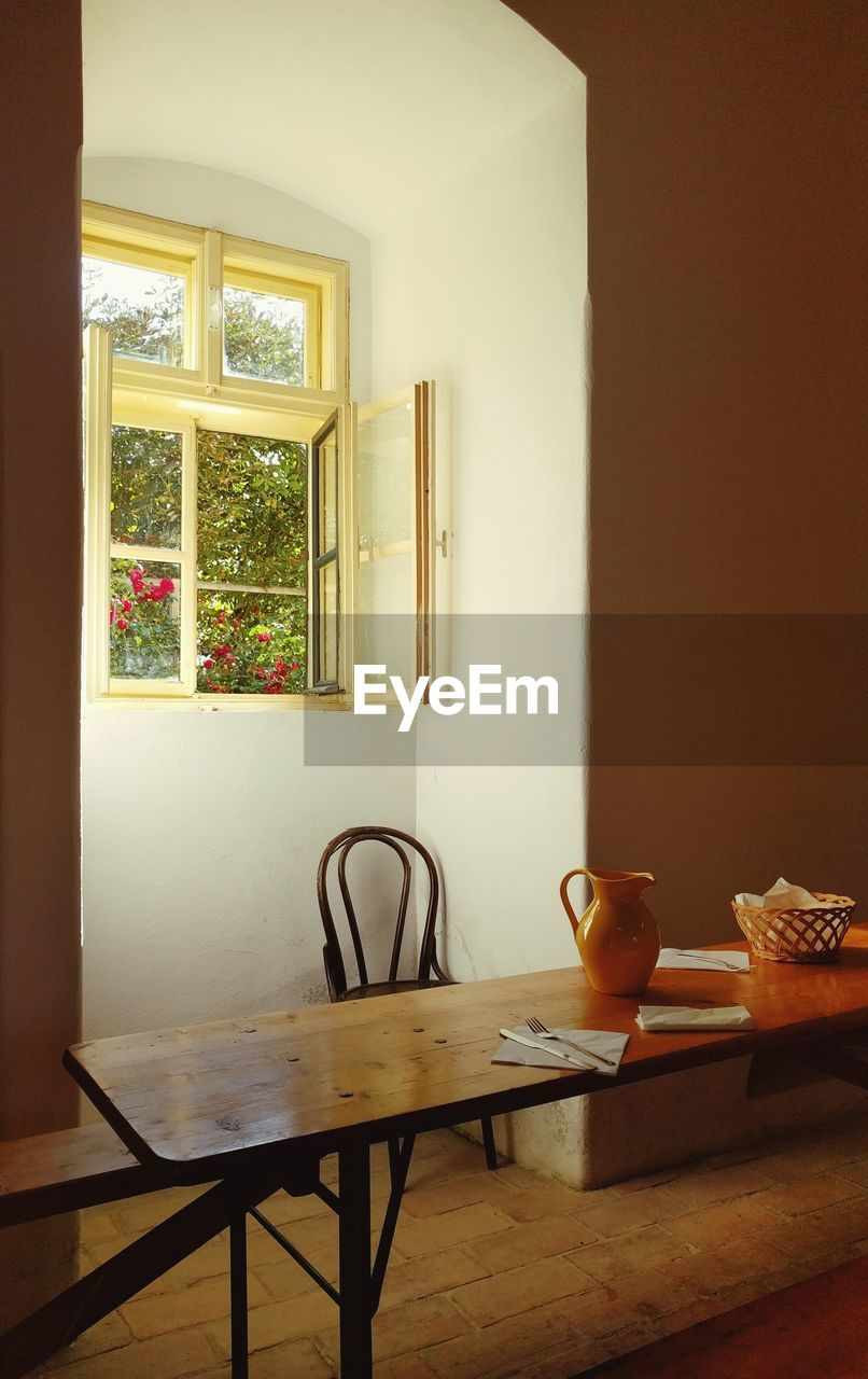 table, indoors, window, home interior, no people, chair, day