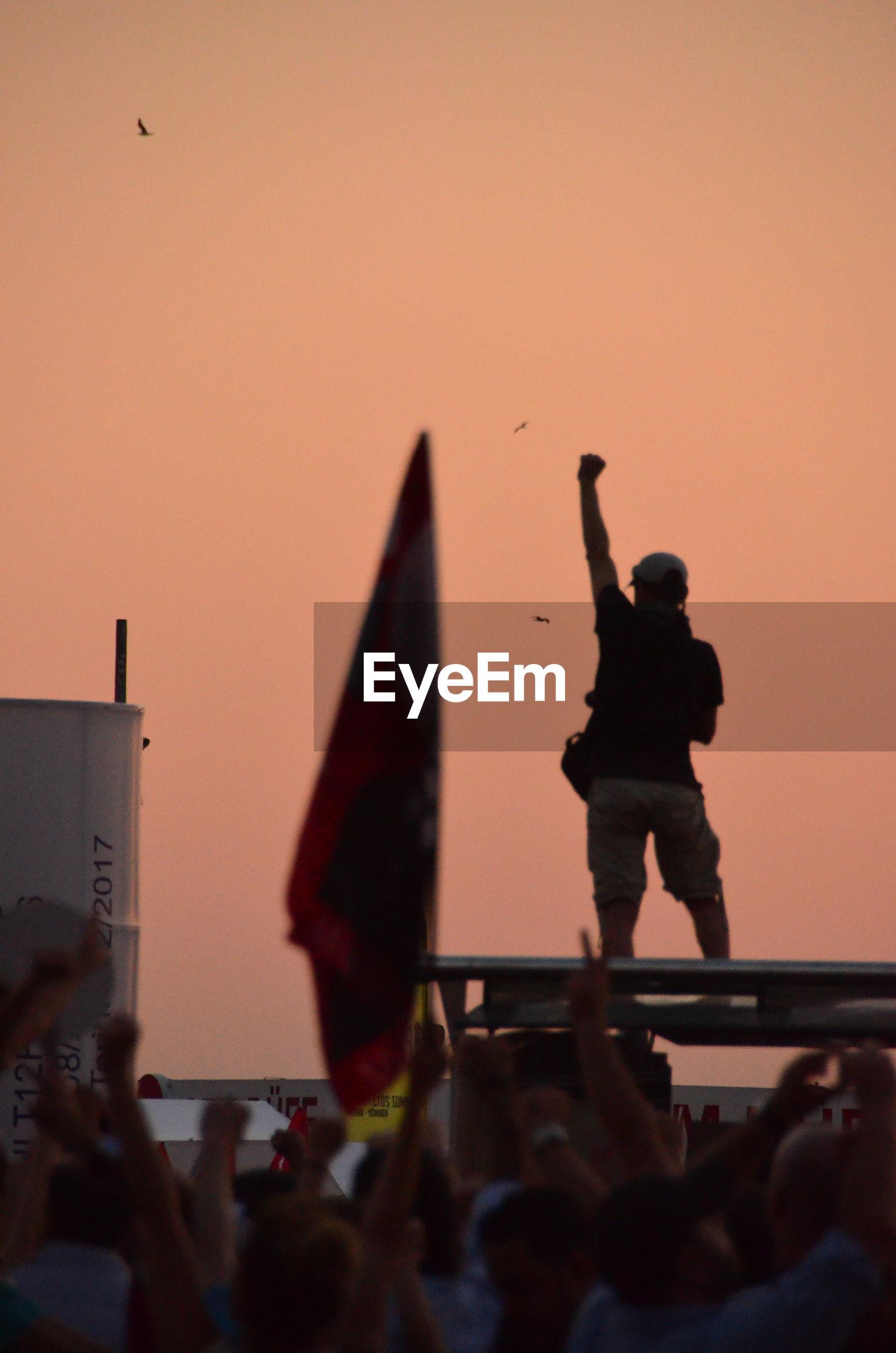 Protestors against orange sky