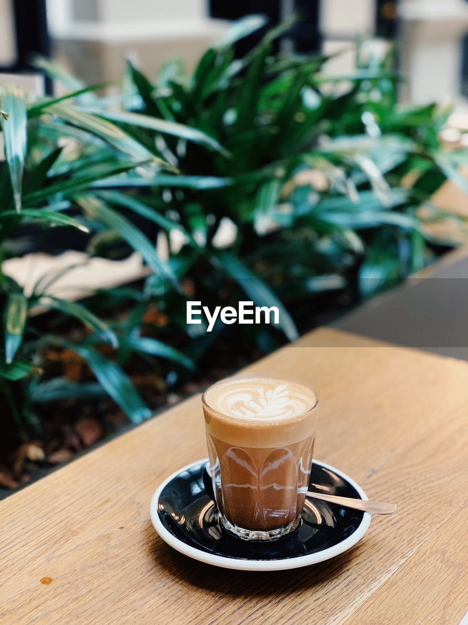food and drink, table, drink, saucer, coffee - drink, coffee, crockery, refreshment, mug, coffee cup, cup, cafe, freshness, spoon, focus on foreground, eating utensil, hot drink, kitchen utensil, latte, food, no people, frothy drink, glass, coffee shop