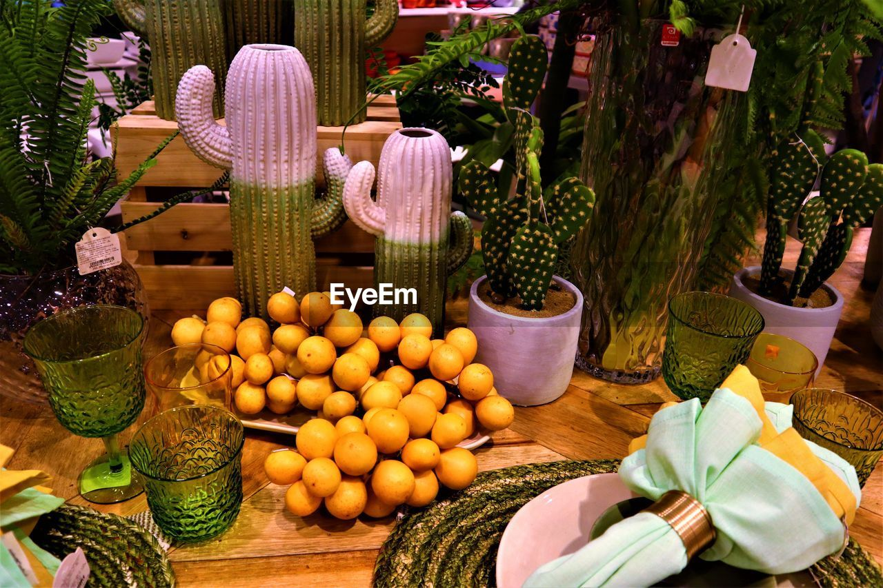 no people, food and drink, freshness, food, healthy eating, variation, choice, plant, fruit, nature, day, potted plant, flower, market, wellbeing, table, retail, flowering plant, large group of objects, close-up, outdoors, retail display
