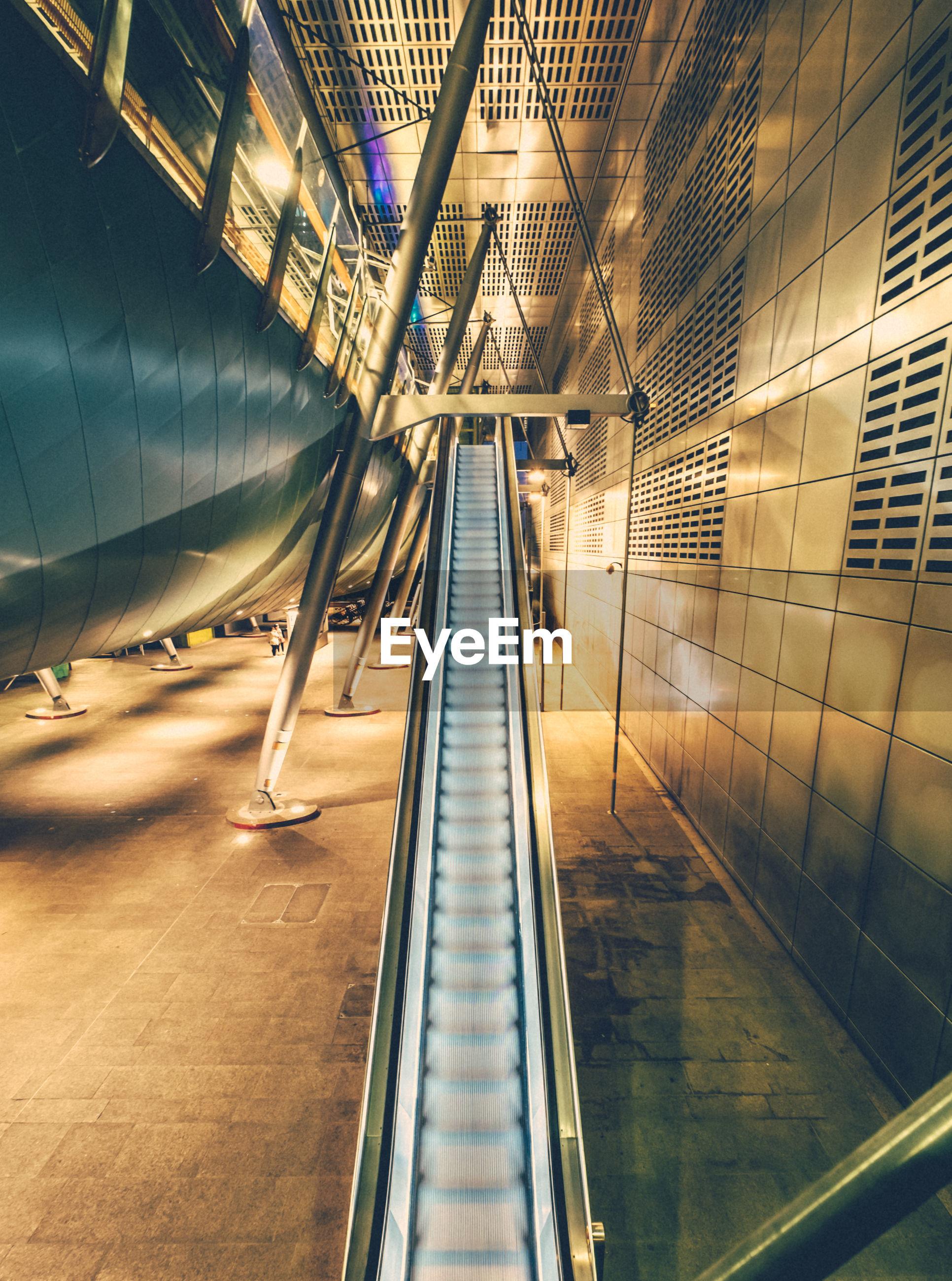 Empty escalator at subway station