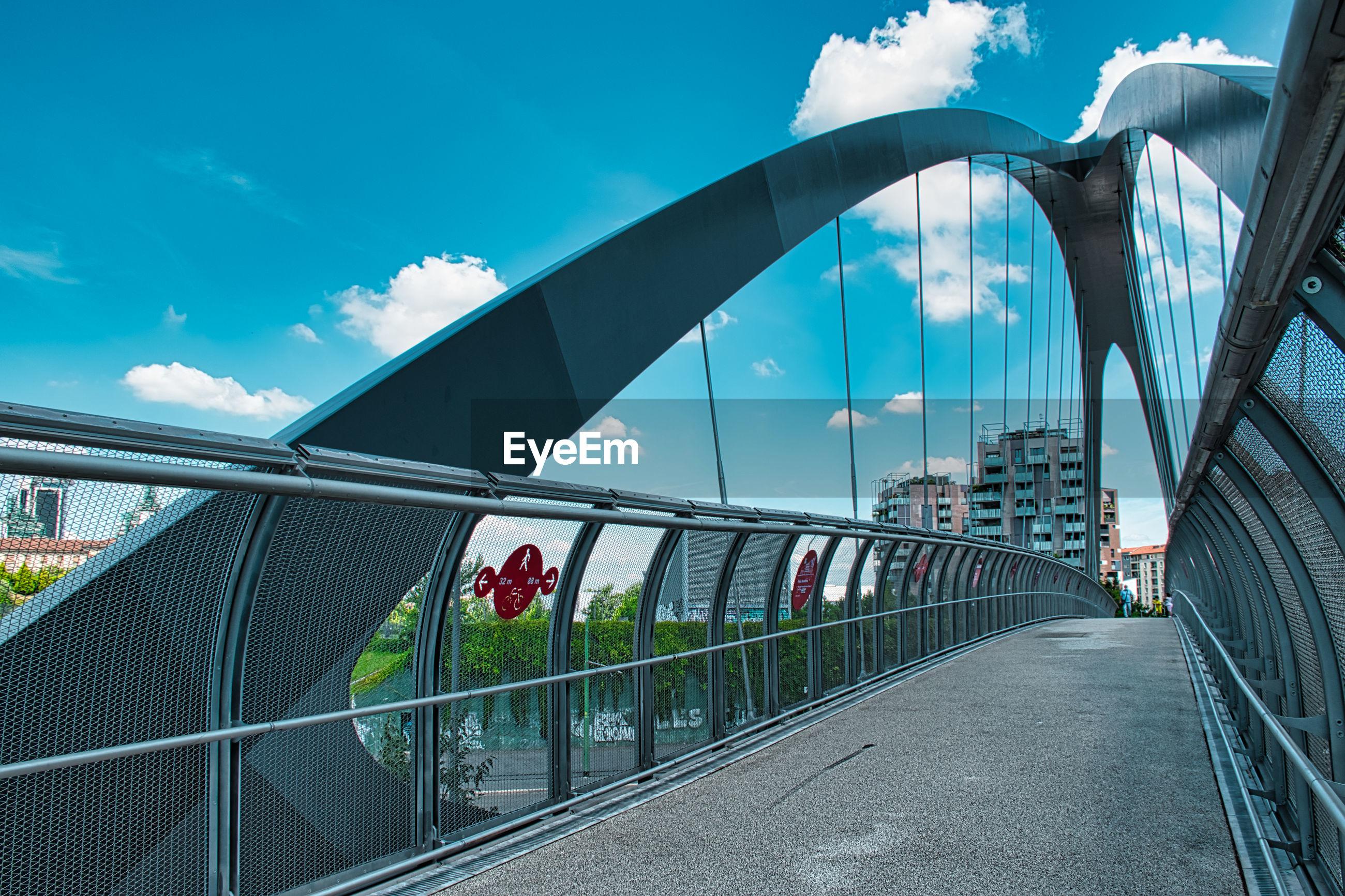 VIEW OF FOOTBRIDGE THROUGH BRIDGE