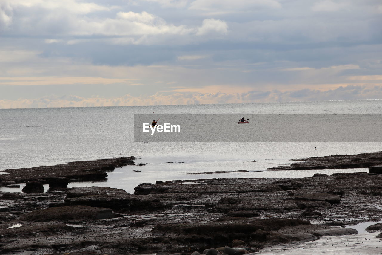 sky, water, cloud - sky, sea, scenics - nature, beauty in nature, nature, horizon over water, horizon, beach, tranquility, tranquil scene, land, non-urban scene, solid, day, idyllic, rock, waterfront, outdoors