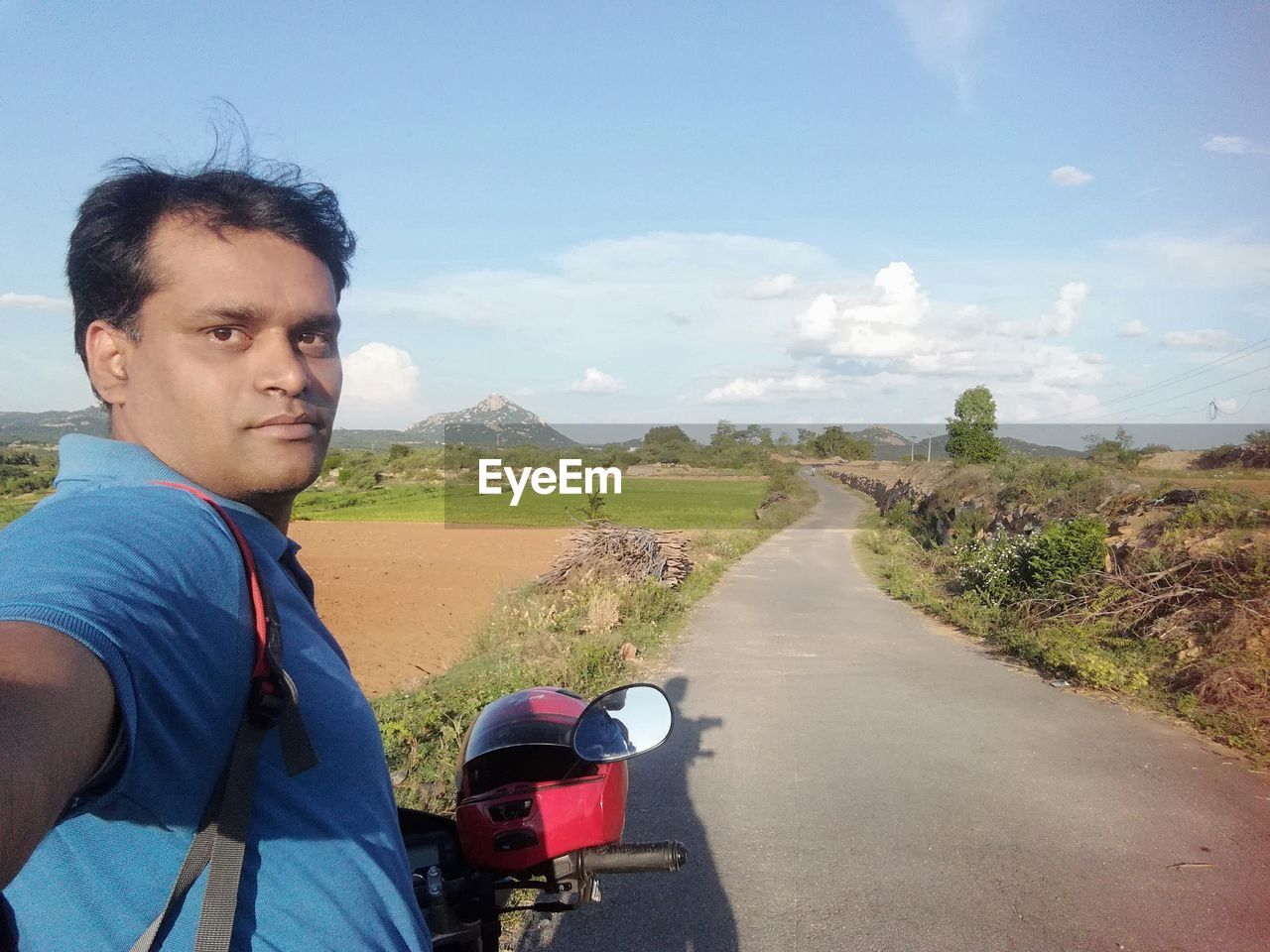 transportation, road, one person, sky, real people, nature, men, lifestyles, day, casual clothing, portrait, mode of transportation, cloud - sky, adult, leisure activity, males, the way forward, direction, side view, mature adult, mature men, riding, outdoors