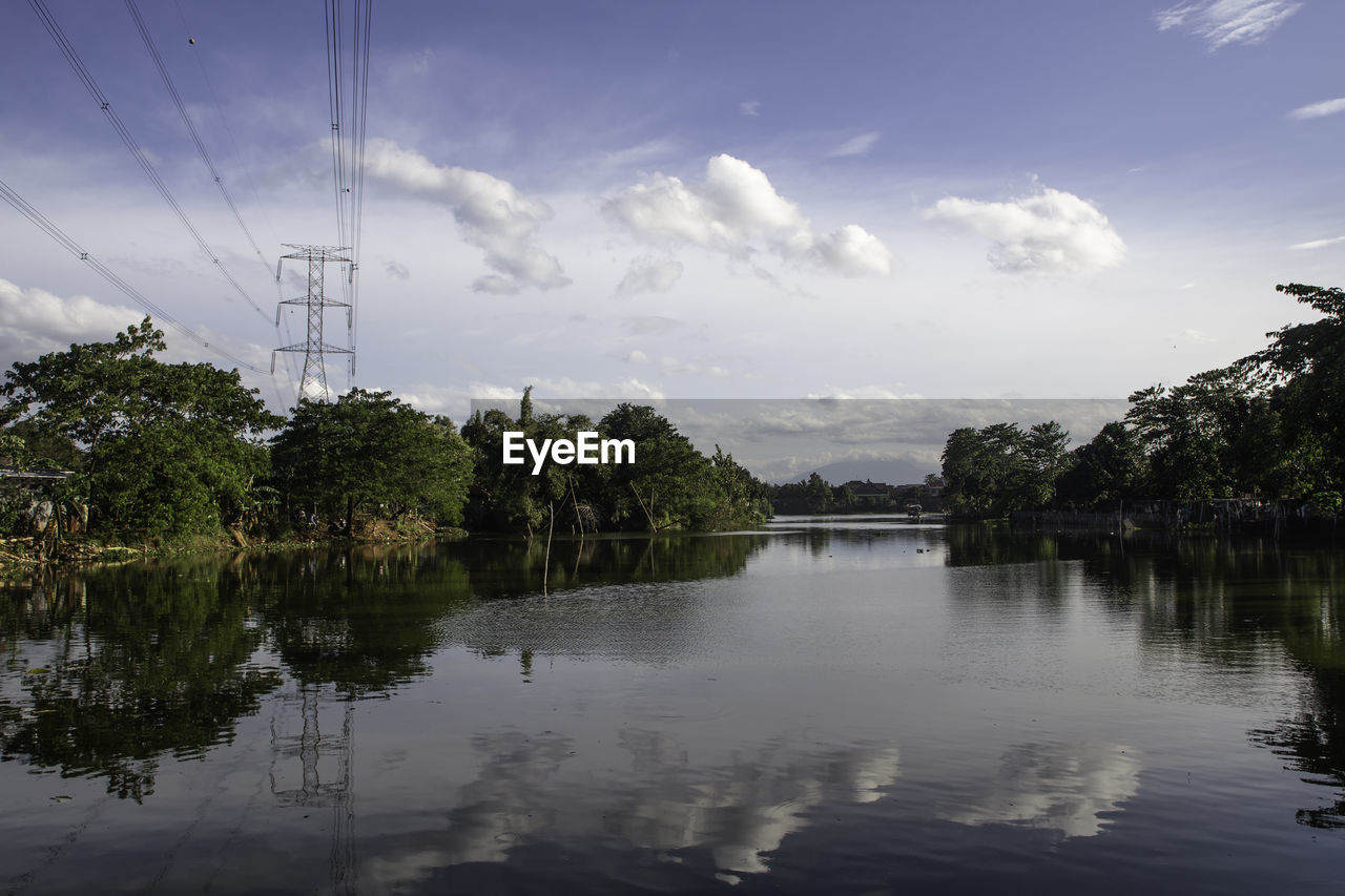 water, sky, reflection, tree, cloud - sky, nature, waterfront, cable, plant, tranquility, electricity pylon, lake, power line, electricity, no people, tranquil scene, connection, beauty in nature, scenics - nature, power supply, outdoors