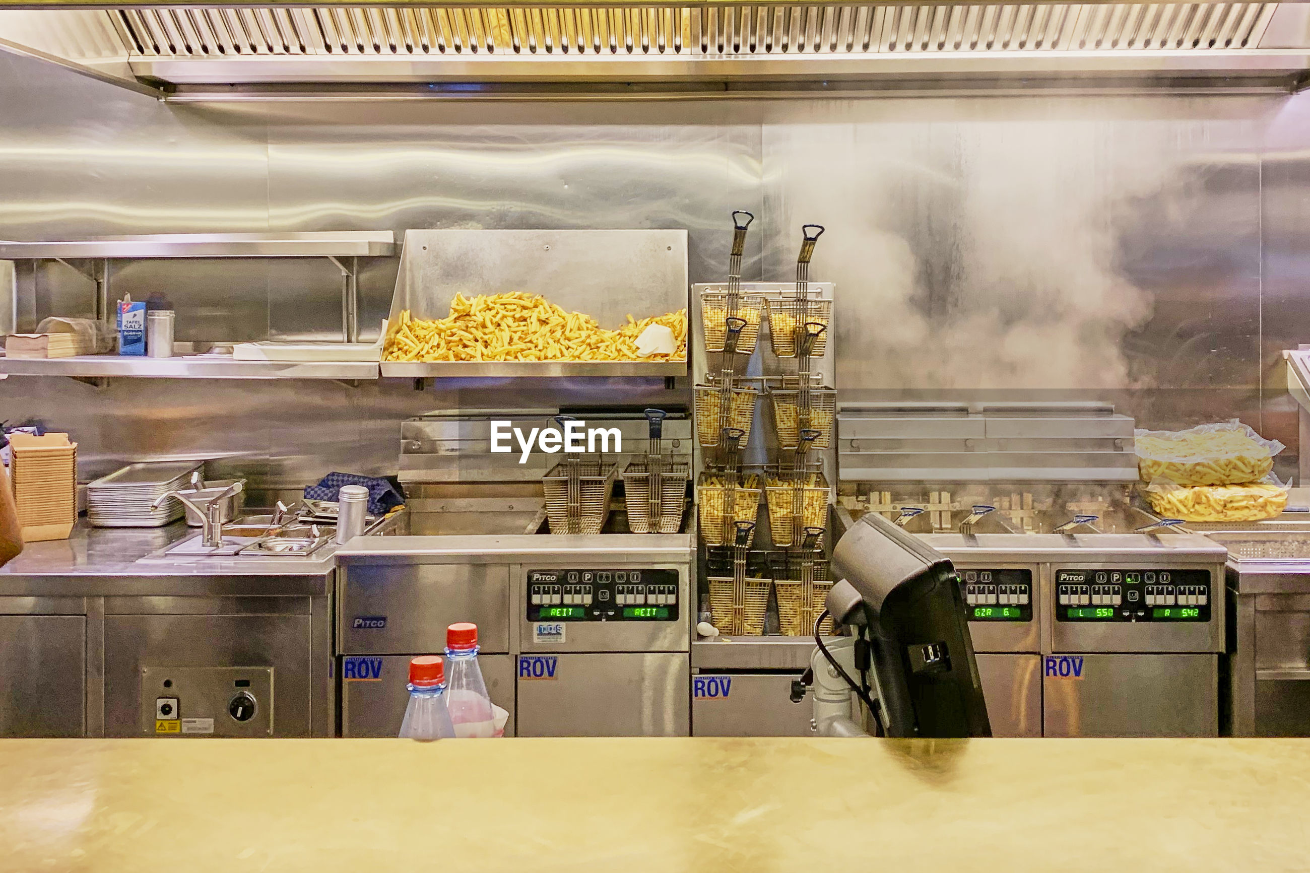 VIEW OF FOOD IN RESTAURANT AT KITCHEN COUNTER