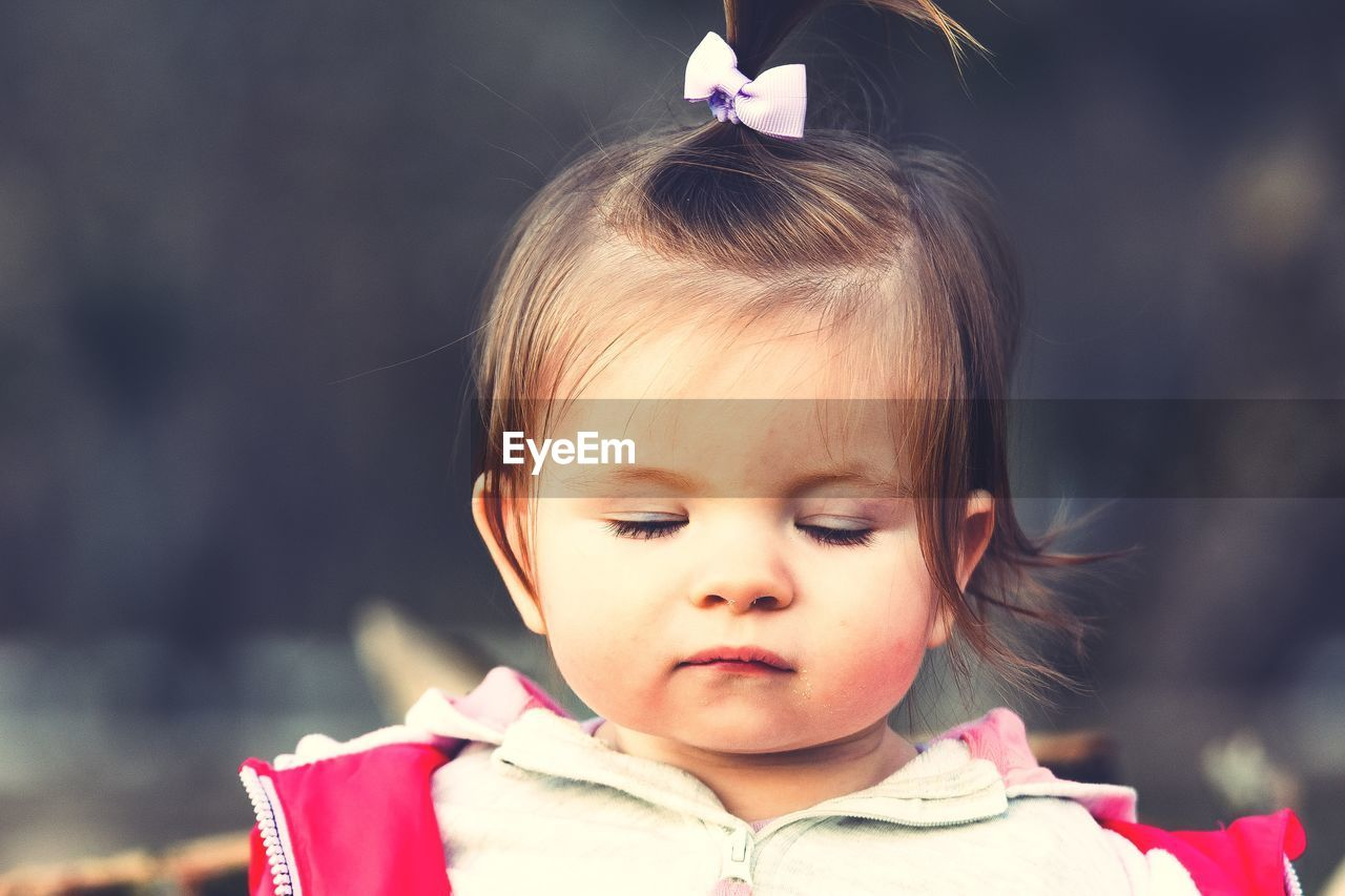 Close-up of cute baby girl with eyes closed