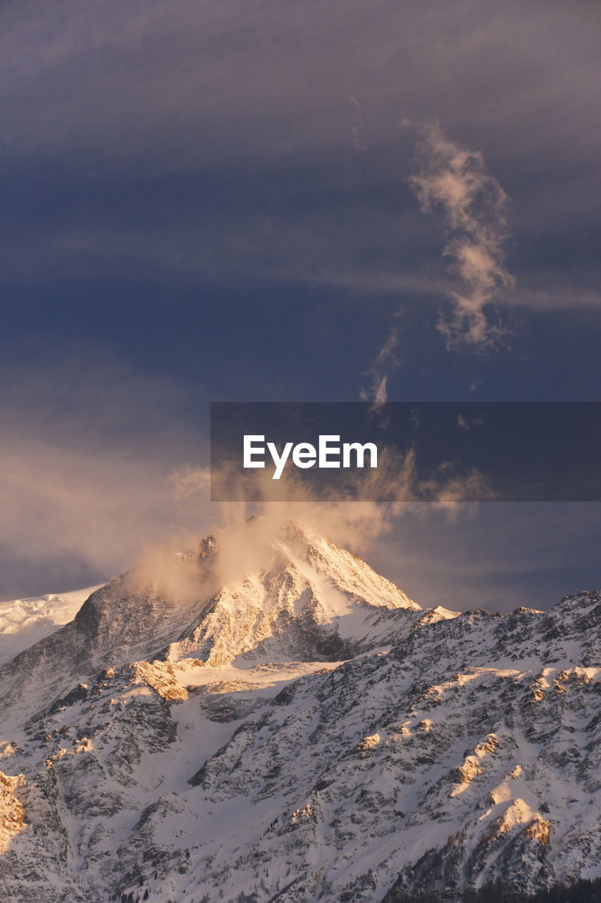 winter, snow, cold temperature, cloud - sky, mountain, scenics - nature, beauty in nature, sky, tranquil scene, environment, smoke - physical structure, non-urban scene, nature, snowcapped mountain, tranquility, landscape, no people, idyllic, volcano, power in nature, outdoors, mountain peak, volcanic crater, pollution