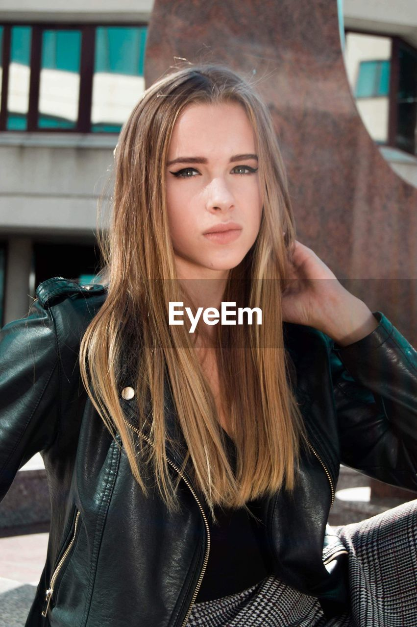 looking at camera, hair, portrait, long hair, one person, hairstyle, beauty, young adult, beautiful woman, young women, front view, lifestyles, leather, architecture, clothing, leisure activity, real people, adult, leather jacket, teenager