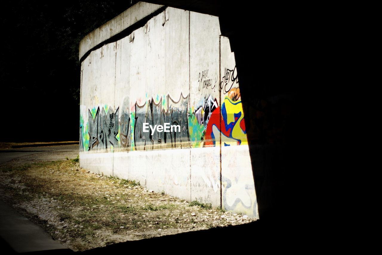 GRAFFITI ON COLORFUL WALL