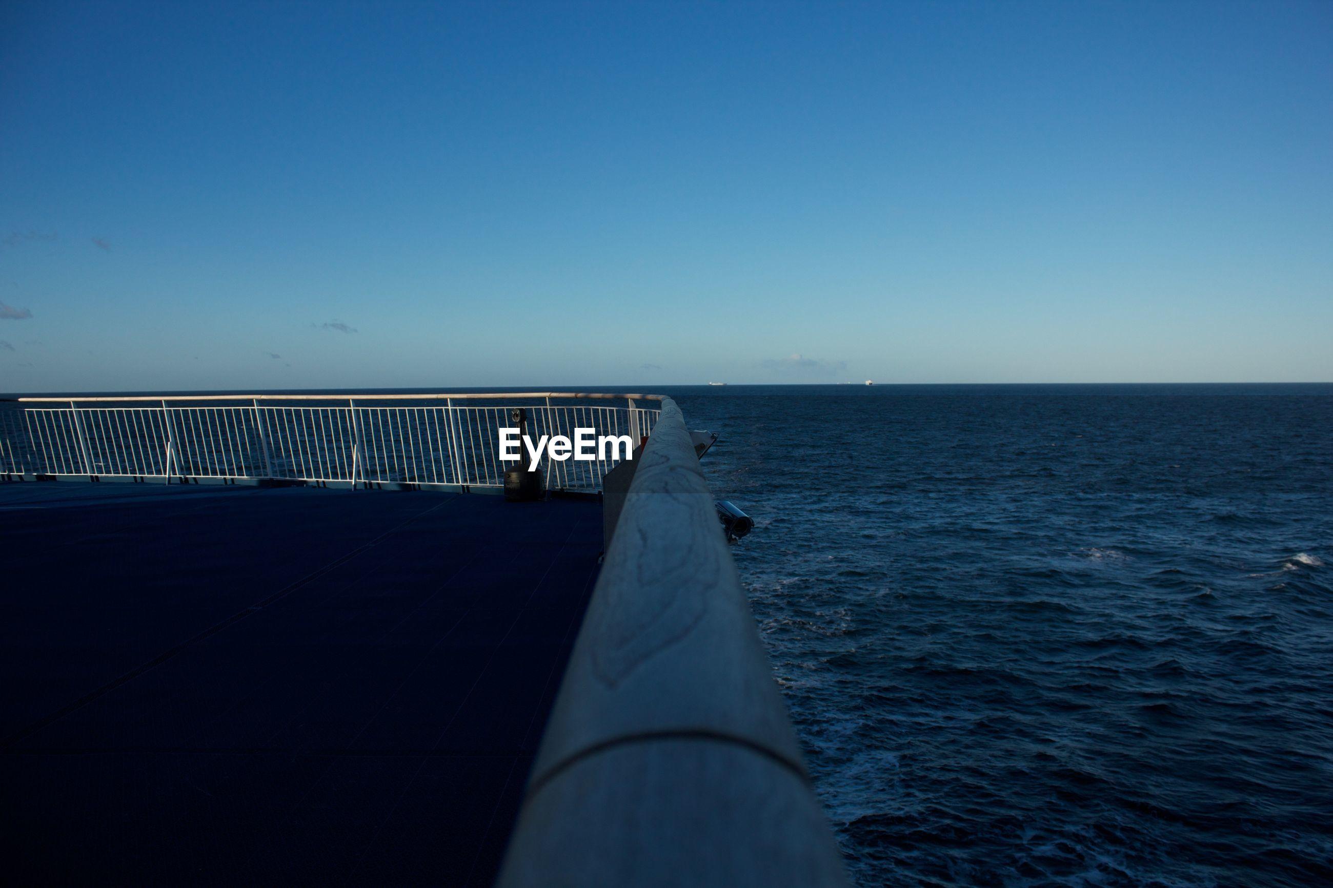 SEA AGAINST CLEAR BLUE SKY
