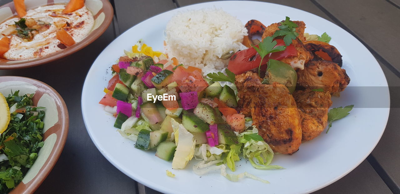 food, plate, food and drink, ready-to-eat, freshness, healthy eating, serving size, table, vegetable, indoors, wellbeing, still life, no people, meat, salad, high angle view, close-up, meal, chicken meat, bowl, dinner, white meat