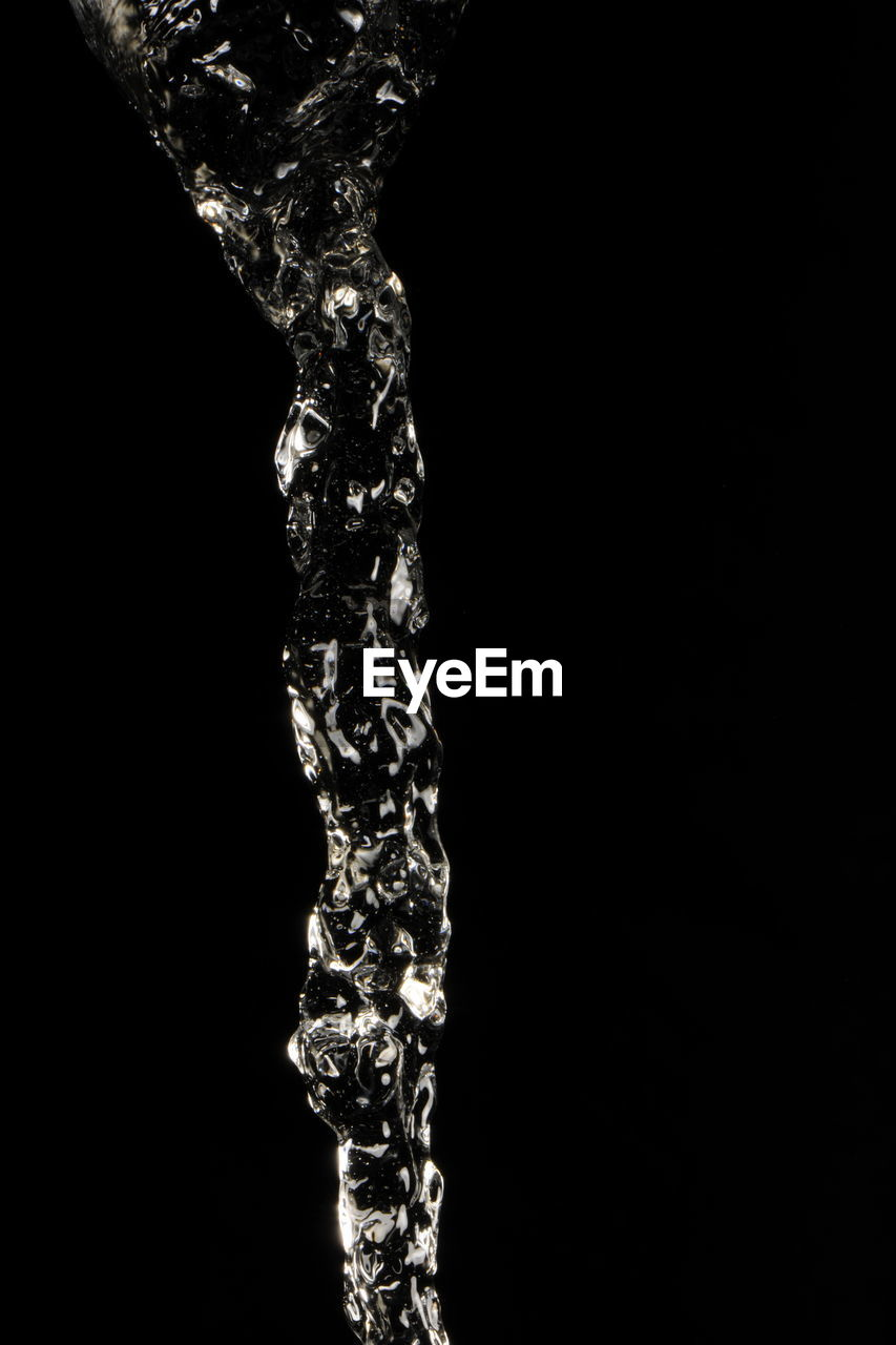 water, splashing, flowing water, purity, liquid, black background, motion, refreshment, drop, studio shot, nature, no people, close-up, freshness, running water, drink, dripping, cold temperature, beauty in nature, splashing droplet, high-speed photography, day