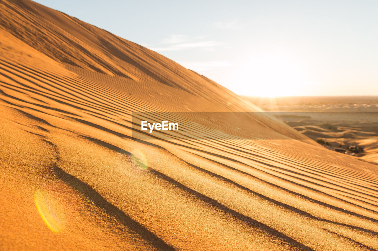desert, sand dune, land, scenics - nature, arid climate, sky, climate, sand, landscape, non-urban scene, tranquility, tranquil scene, environment, beauty in nature, nature, pattern, sunlight, no people, remote, day, atmospheric