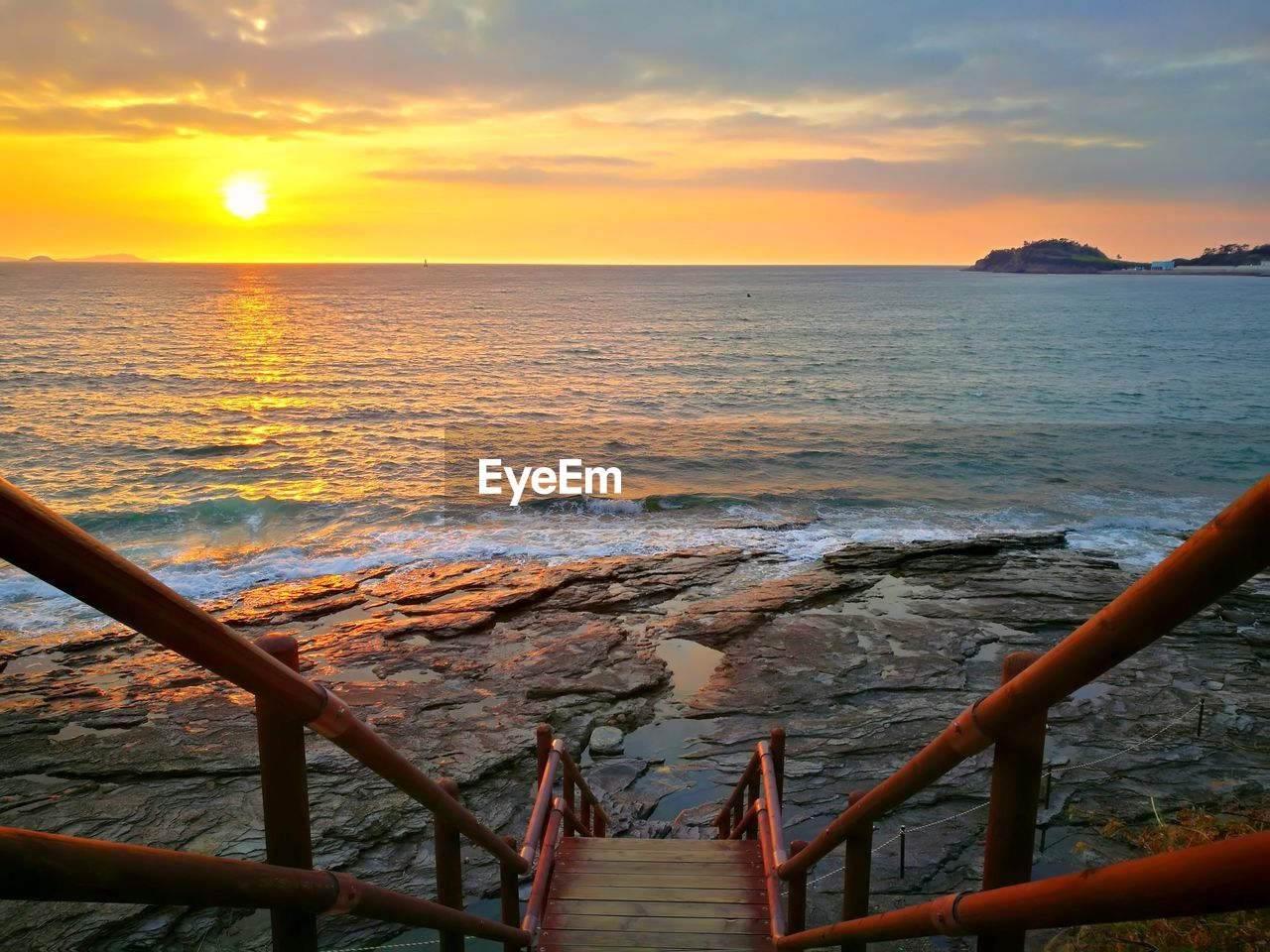sunset, water, sky, sea, scenics - nature, beauty in nature, orange color, railing, horizon over water, nature, horizon, cloud - sky, idyllic, tranquility, tranquil scene, no people, outdoors, land, beach