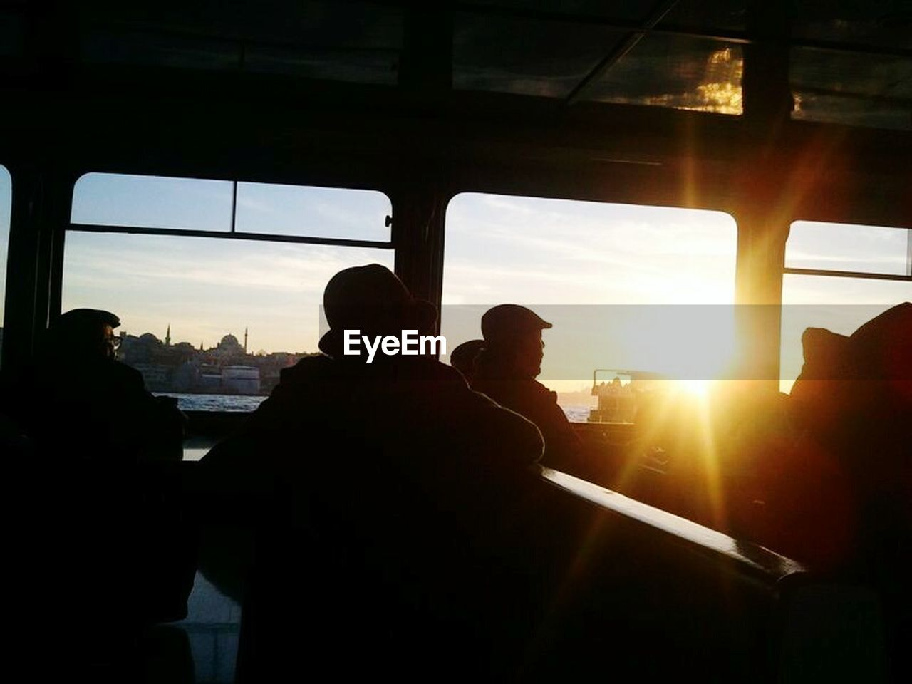 silhouette, sunset, transportation, sunlight, sun, sky, men, window, real people, sitting, two people, lifestyles, indoors, day, adult, nature, only men, people, adults only