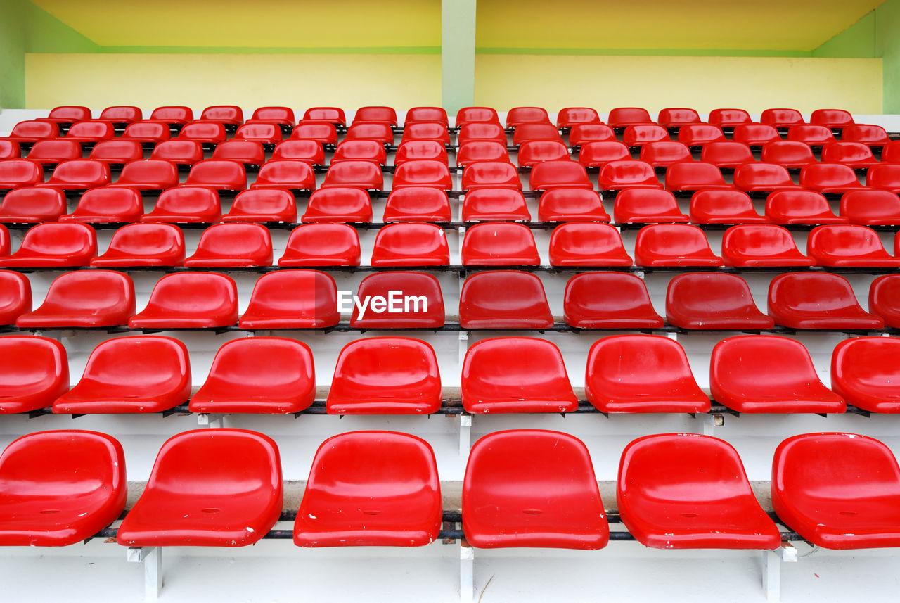 Red Bleachers In Sport Stadium