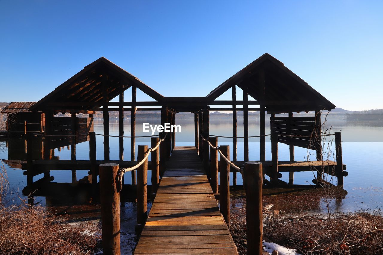 sky, built structure, architecture, water, wood - material, clear sky, nature, pier, the way forward, land, tranquility, blue, beach, sea, day, scenics - nature, direction, beauty in nature, tranquil scene, no people, wood, outdoors