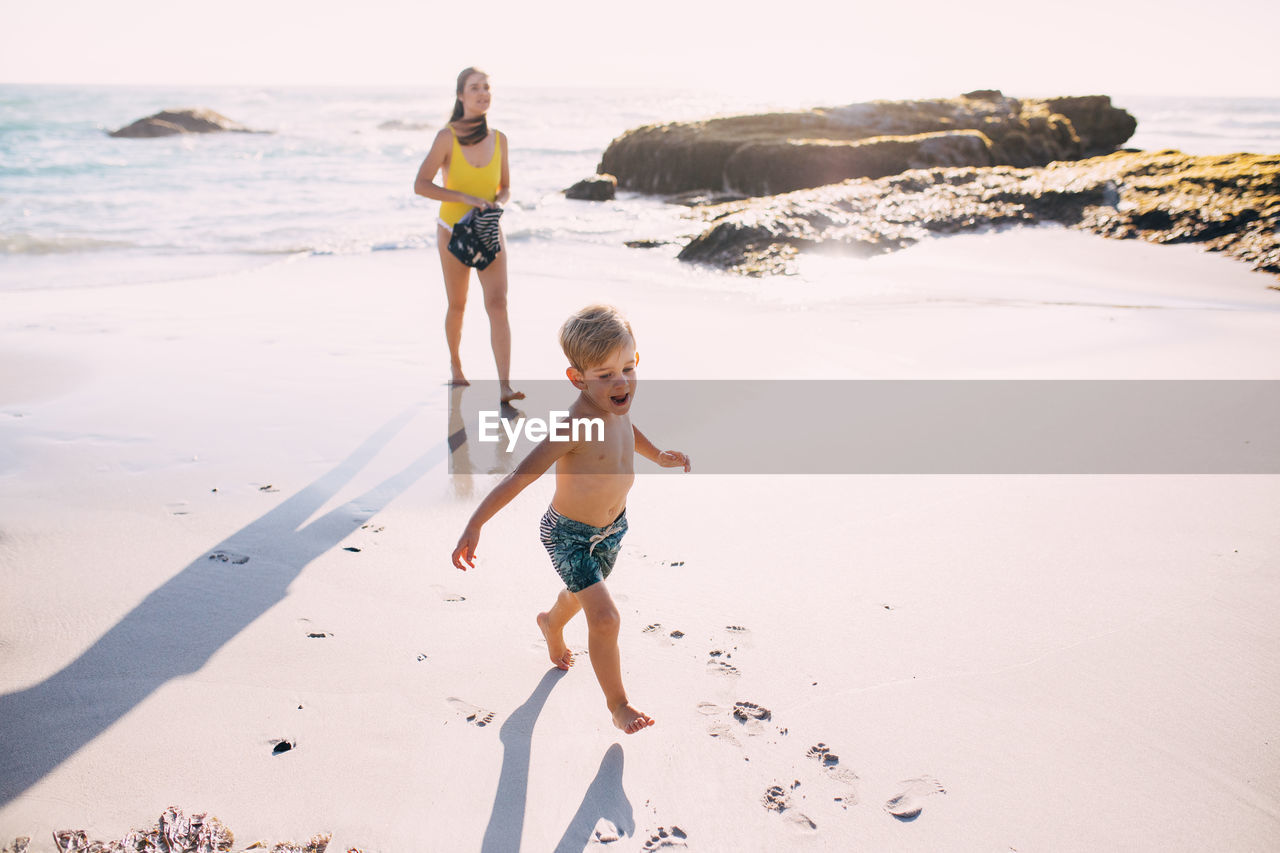 child, childhood, boys, males, beach, land, full length, water, shirtless, leisure activity, real people, sea, men, nature, lifestyles, family, togetherness, innocence