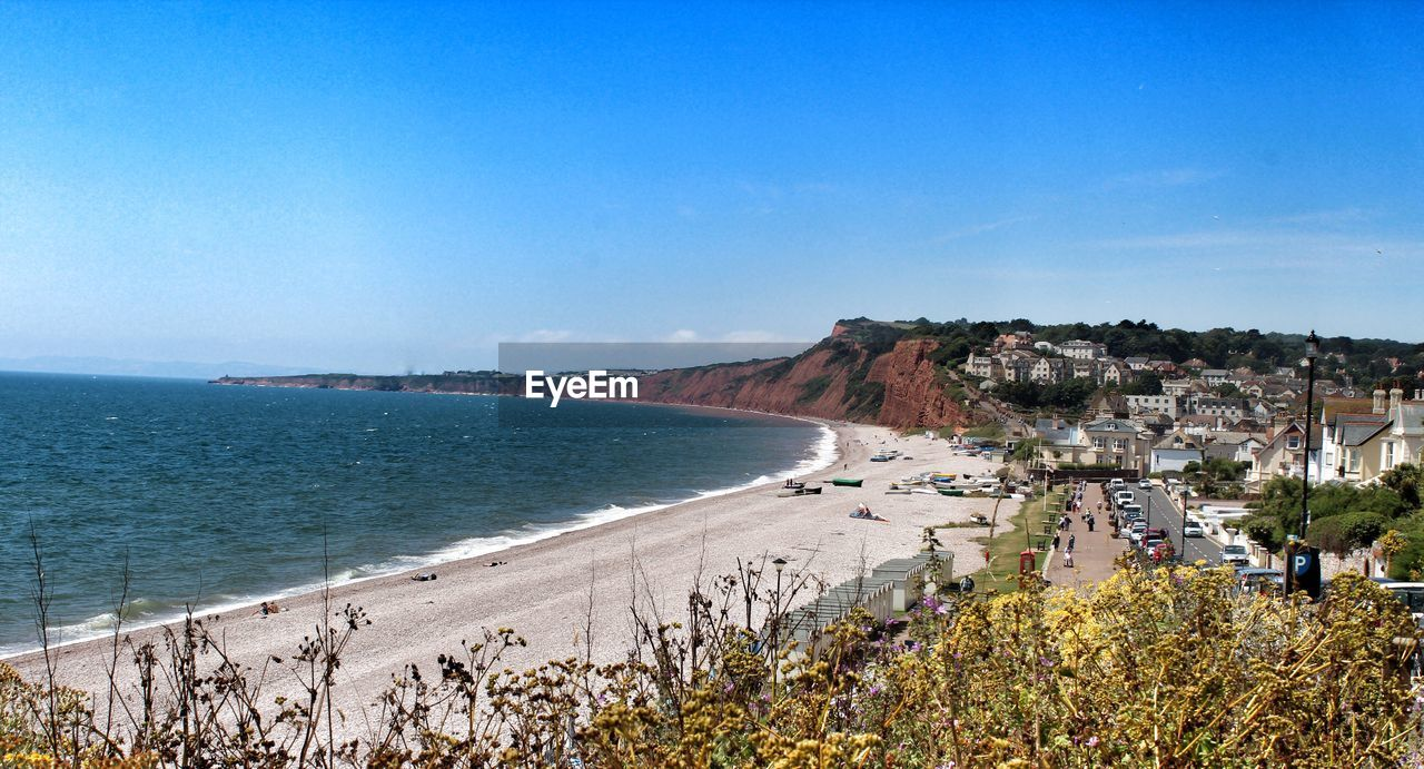 High Angle View Of Budleigh Salterton By Sea Against Blue Sky