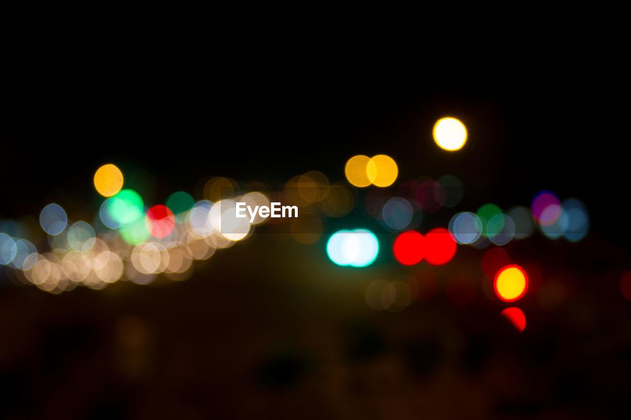 illuminated, night, defocused, light effect, no people, multi colored, close-up, outdoors, black background