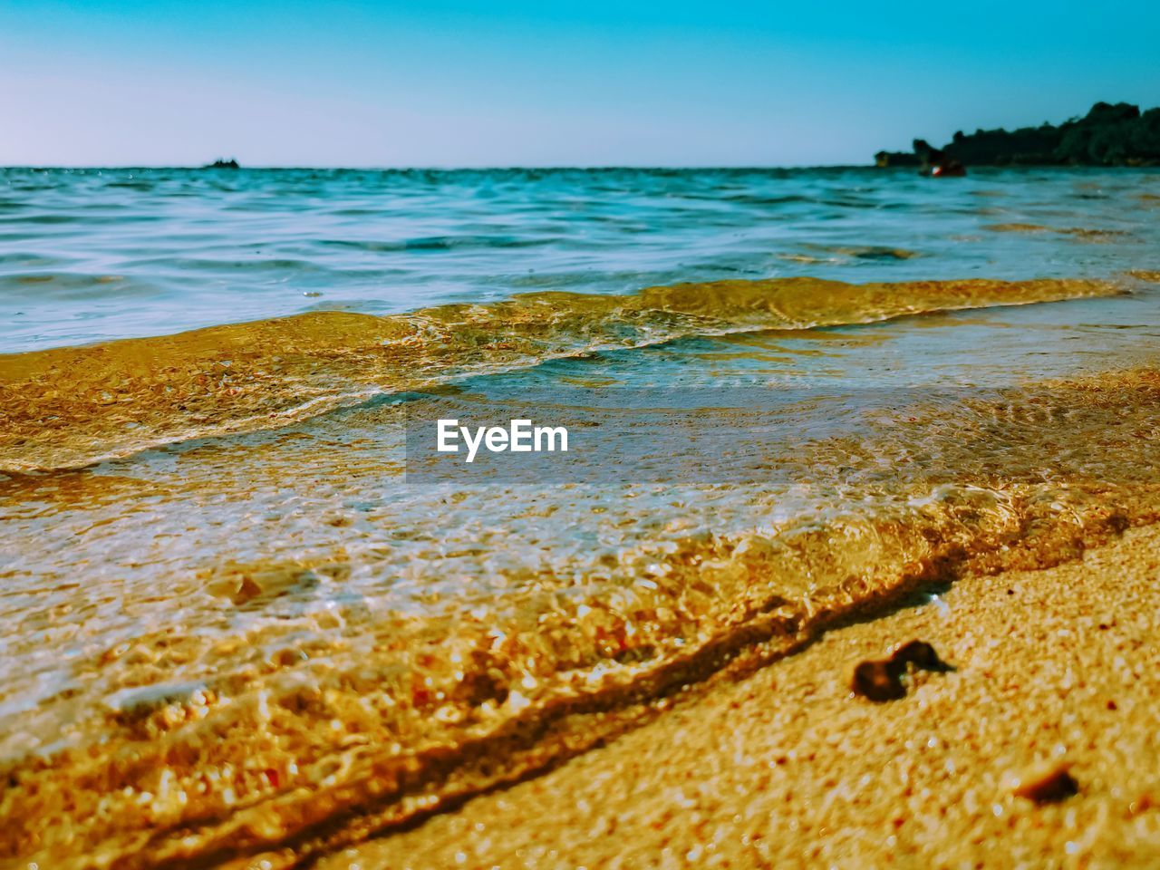 sea, water, beach, land, wave, motion, beauty in nature, scenics - nature, no people, sky, nature, sport, aquatic sport, tranquility, day, outdoors, horizon over water, sand, surface level