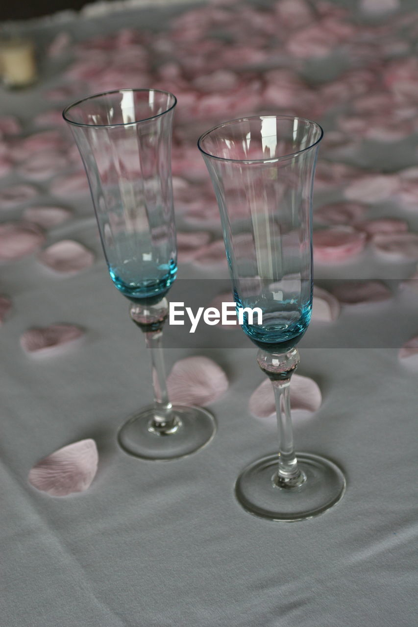 Glasses and petals on tablecloth