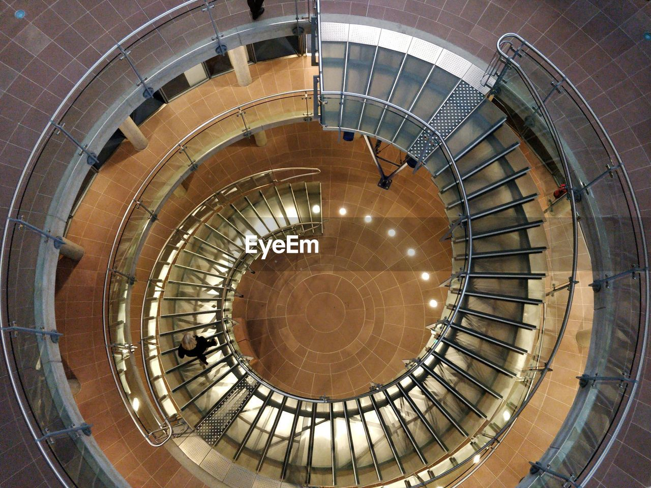 spiral, staircase, steps and staircases, spiral staircase, architecture, railing, indoors, built structure, high angle view, directly above, no people, pattern, directly below, design, shape, absence, day, metal, diminishing perspective, modern, concentric