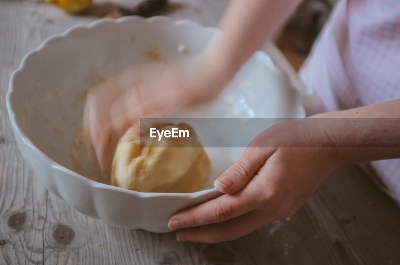 Close-Up Of Hand Kneading Dough
