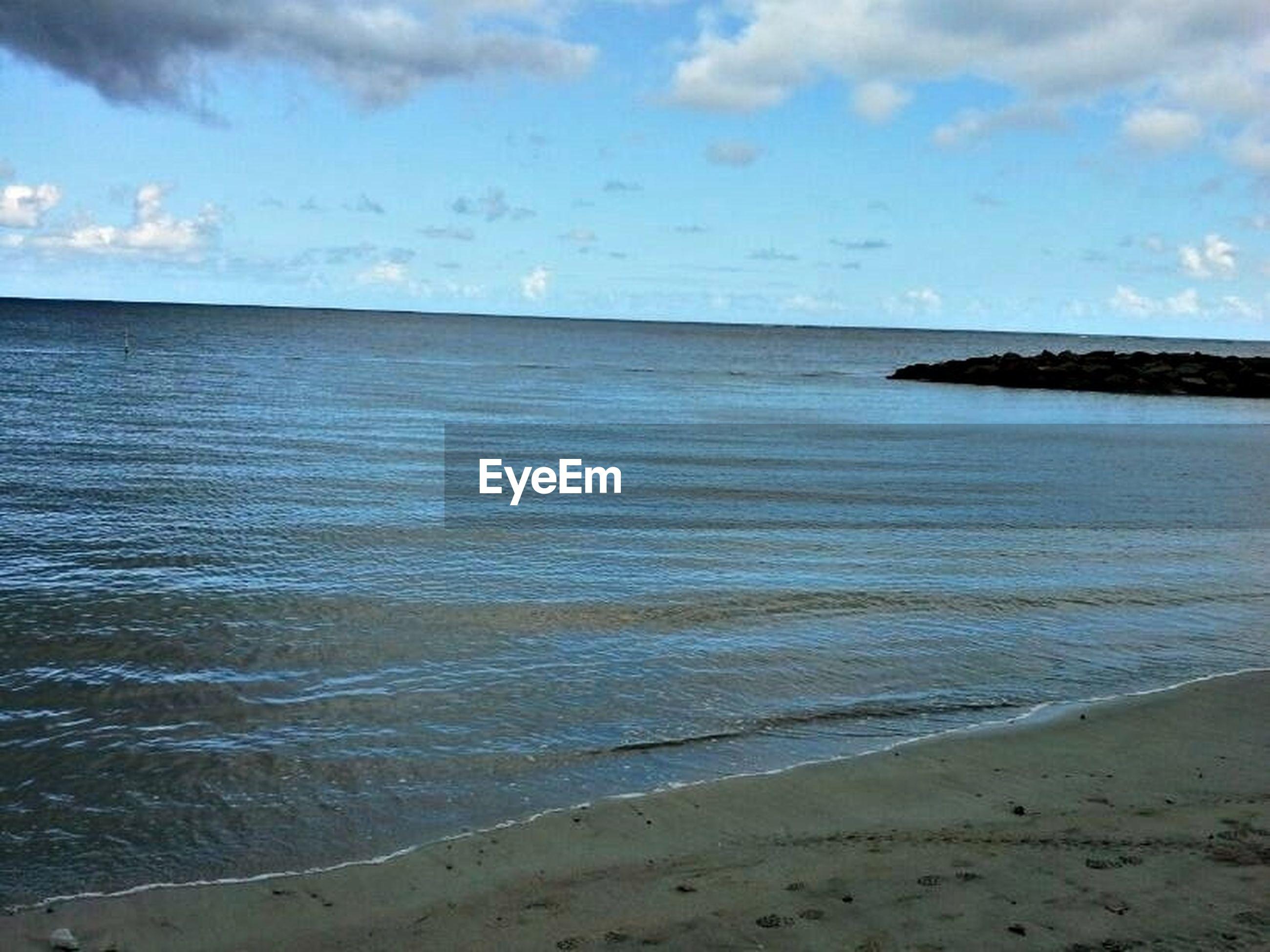 sea, water, horizon over water, beach, sky, tranquil scene, tranquility, scenics, shore, beauty in nature, sand, nature, cloud, cloud - sky, idyllic, coastline, calm, blue, seascape, remote
