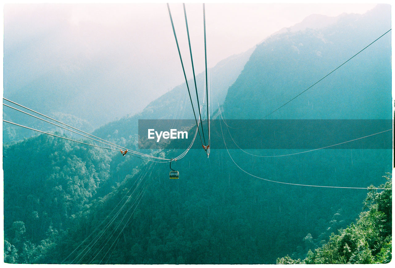 High Angle View Of Overhead Cable Car Against Mountains