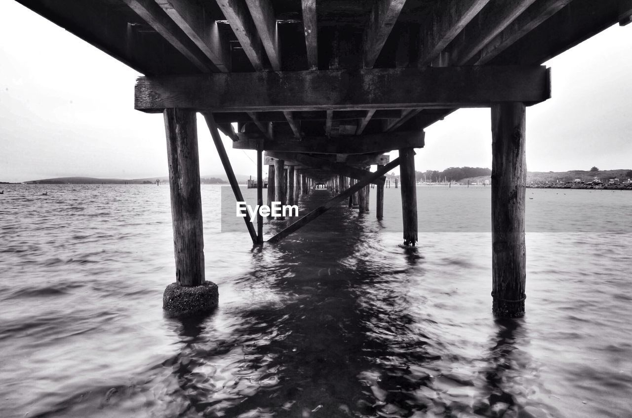 water, sea, connection, underneath, bridge - man made structure, pier, built structure, architecture, outdoors, below, no people, day, waterfront, horizon over water, nature, sky