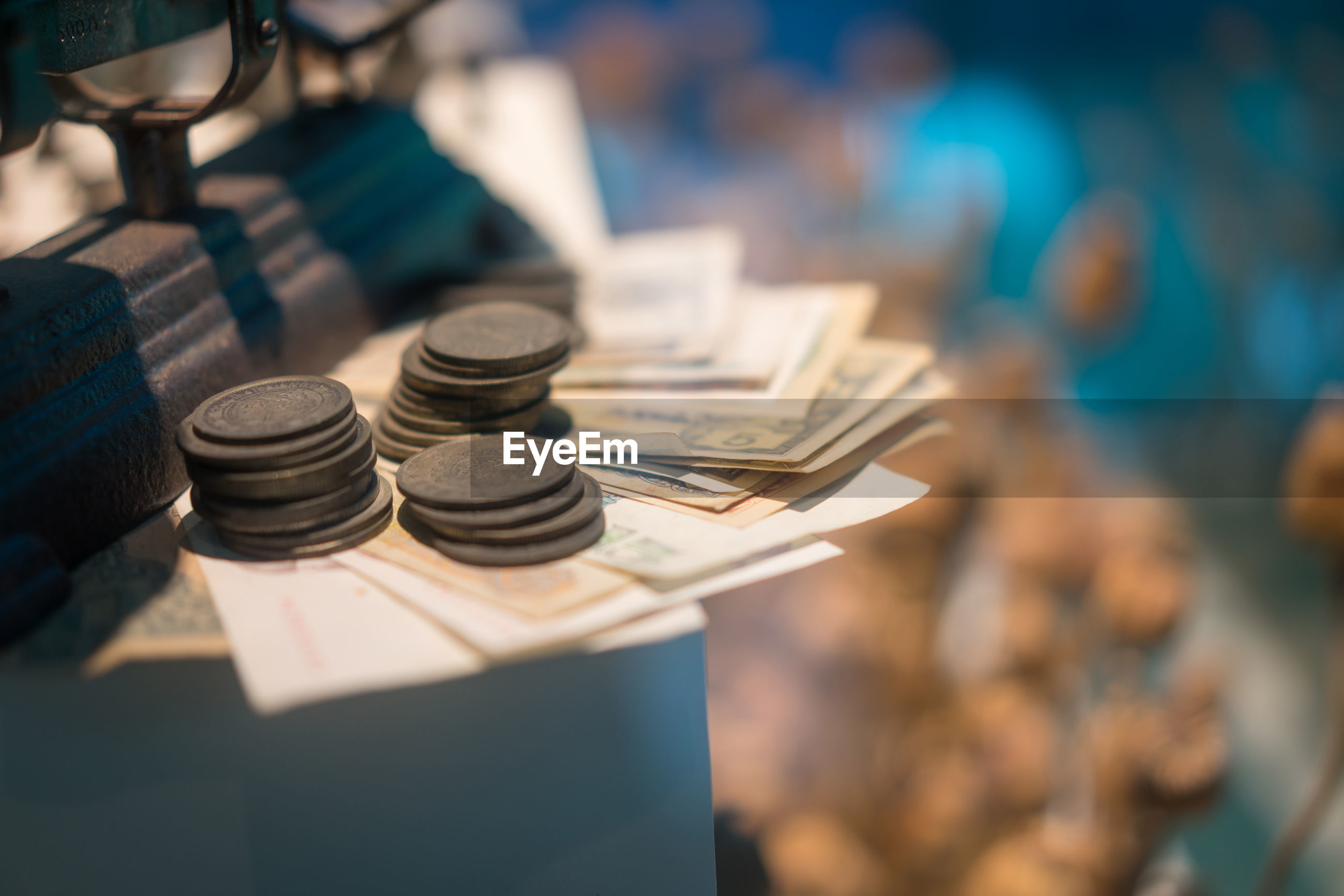 High angle view of weight scale with money on table