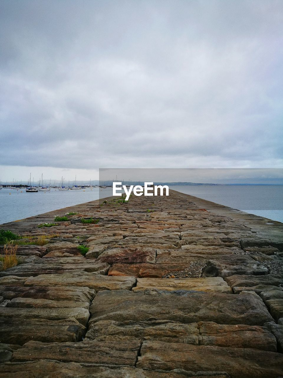 sky, cloud - sky, water, sea, nature, scenics - nature, land, tranquility, tranquil scene, beauty in nature, day, rock, beach, solid, rock - object, horizon, no people, horizon over water, non-urban scene, outdoors, groyne