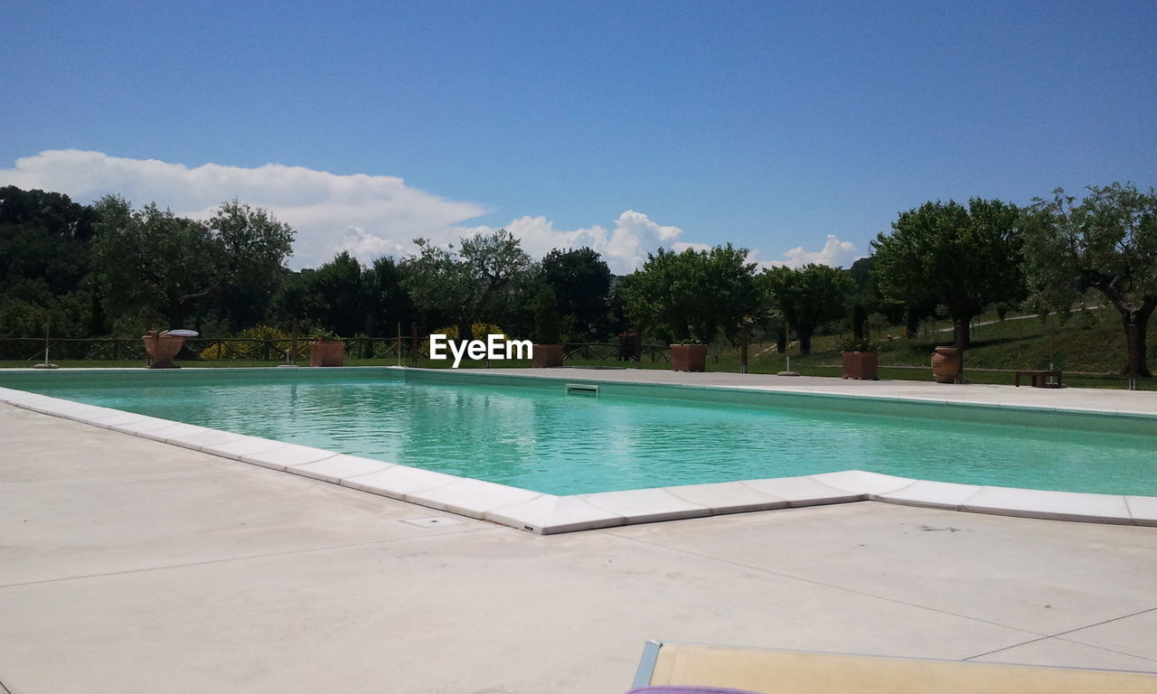 swimming pool, water, poolside, tree, no people, outdoors, day, sky, nature
