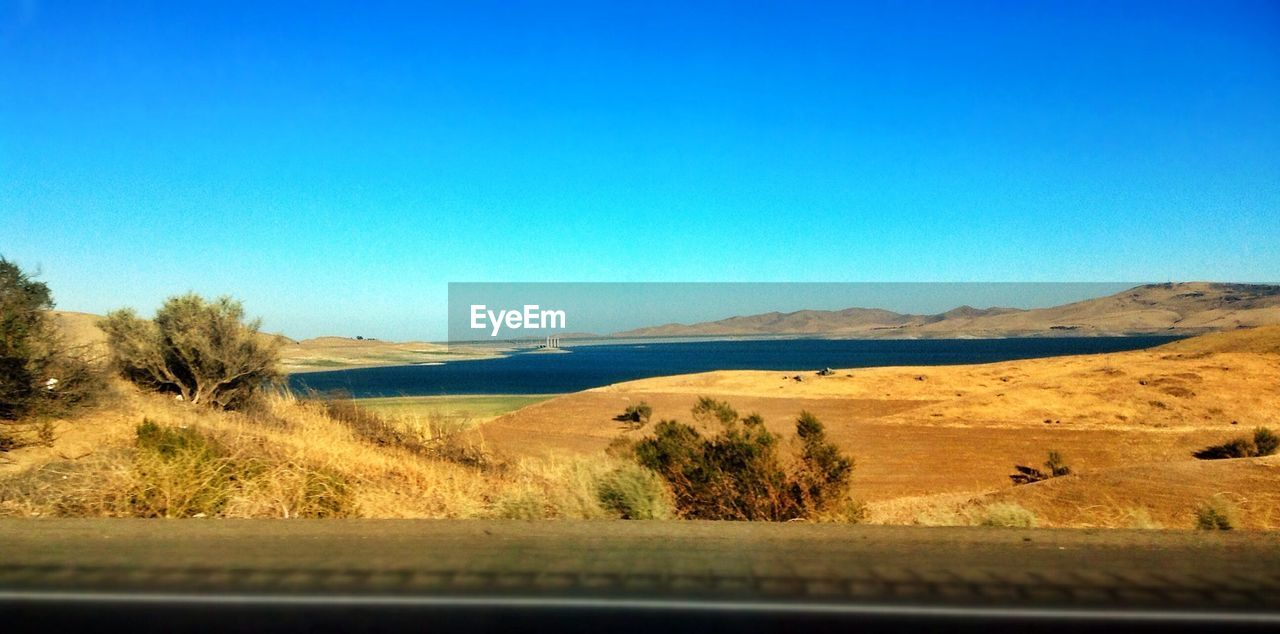 San Luis Reservoir Against Clear Blue Sky