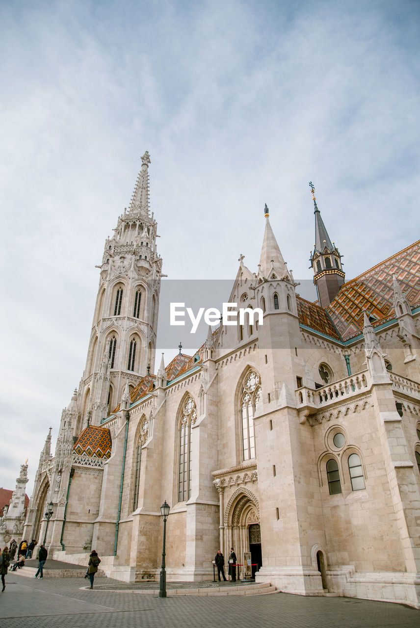 building exterior, architecture, built structure, religion, place of worship, building, belief, sky, spirituality, low angle view, travel destinations, tourism, travel, the past, cloud - sky, history, nature, arch, outdoors, gothic style, spire
