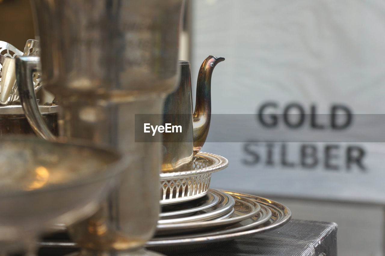 Close-up of antique silver utensils at store