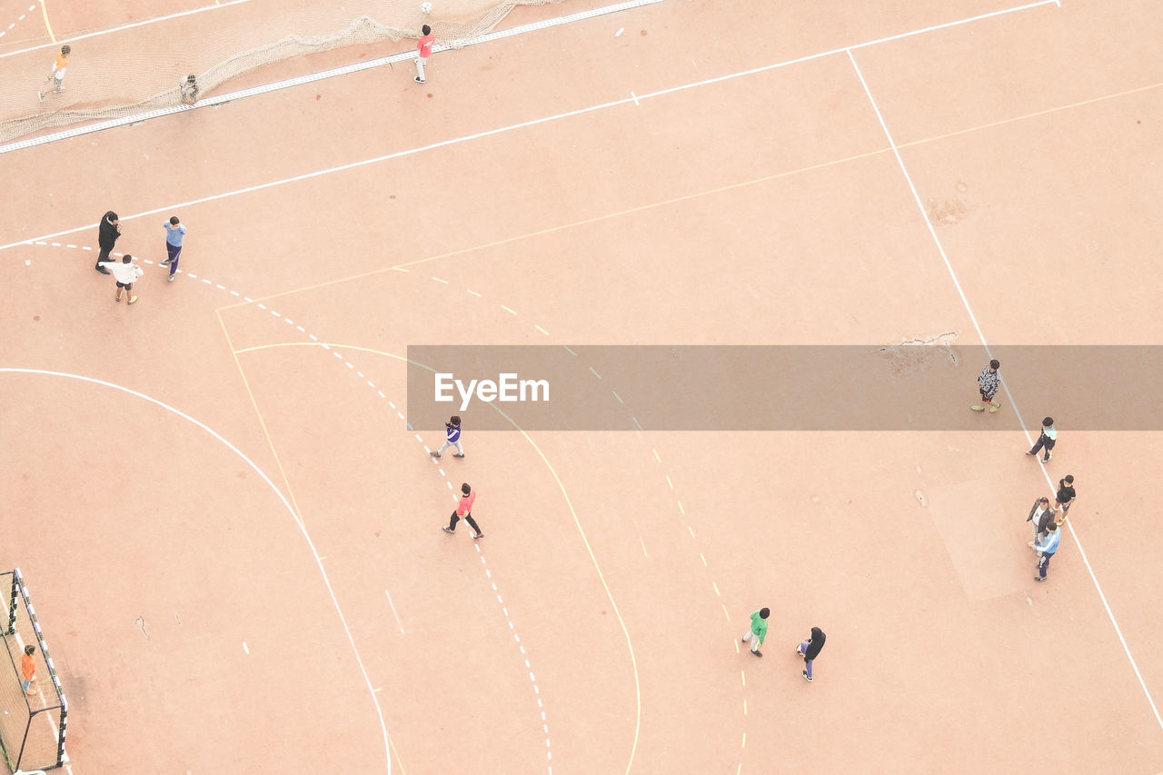 High Angle View Of People On Soccer Field