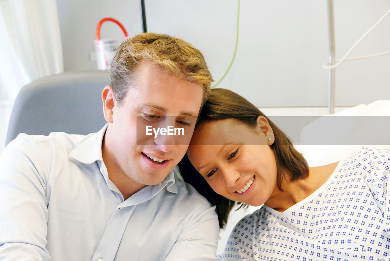 Happy Young Couple In Hospital