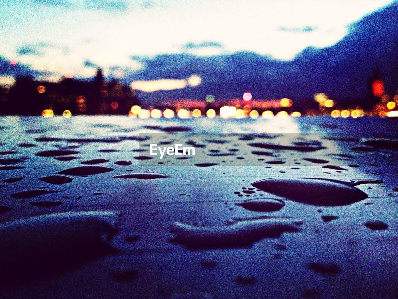car, transportation, wet, street, drop, land vehicle, water, no people, outdoors, sky, close-up, illuminated, day, nature