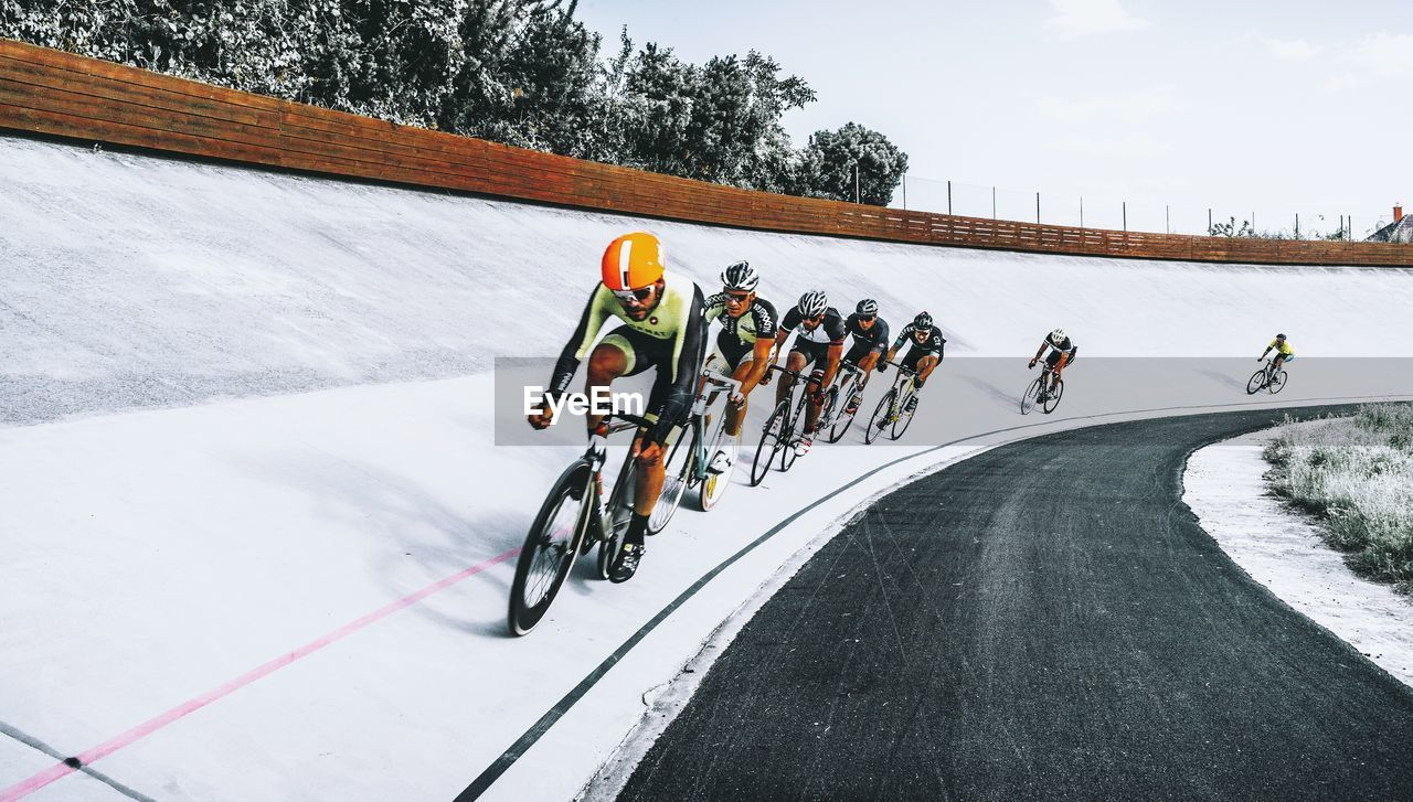 winter, cold temperature, outdoors, sports race, snow, large group of people, day, sport, competition, helmet, speed, bicycle, nature, road, athlete, real people, men, sportsman, full length, competitive sport, sports clothing, sports track, sky, people