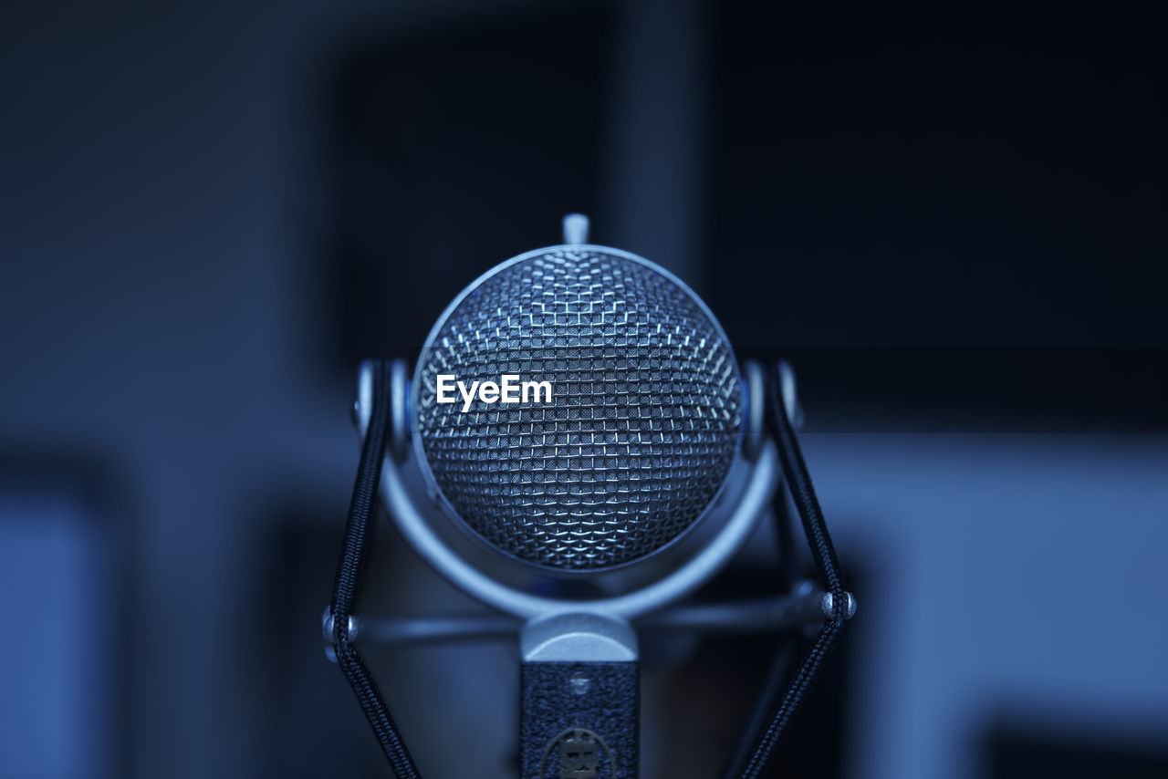 Close-Up Of Microphone Against Blurred Background